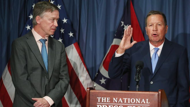 Ohio Gov. John Kasich and Colorado Gov. John Hickenlooper participate in a news conference to discuss the Senate health care bill on June 27, 2017, in Washington.