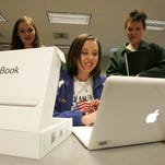 Thomas Wells Tupelo seniors like Kelli Heath, 17, center, couldn't wait to get their hands on their new MacBooks Monday at the Performing Arts Center. For those seniors who didn't pick up their laptop they have two more chances Tuesday and Wednesday night from 5:15-6 at the Performing Arts Center and then on Saturday Feb. 13th there will be a Orientation and training at 9:30 a.m. in the cafeteria.