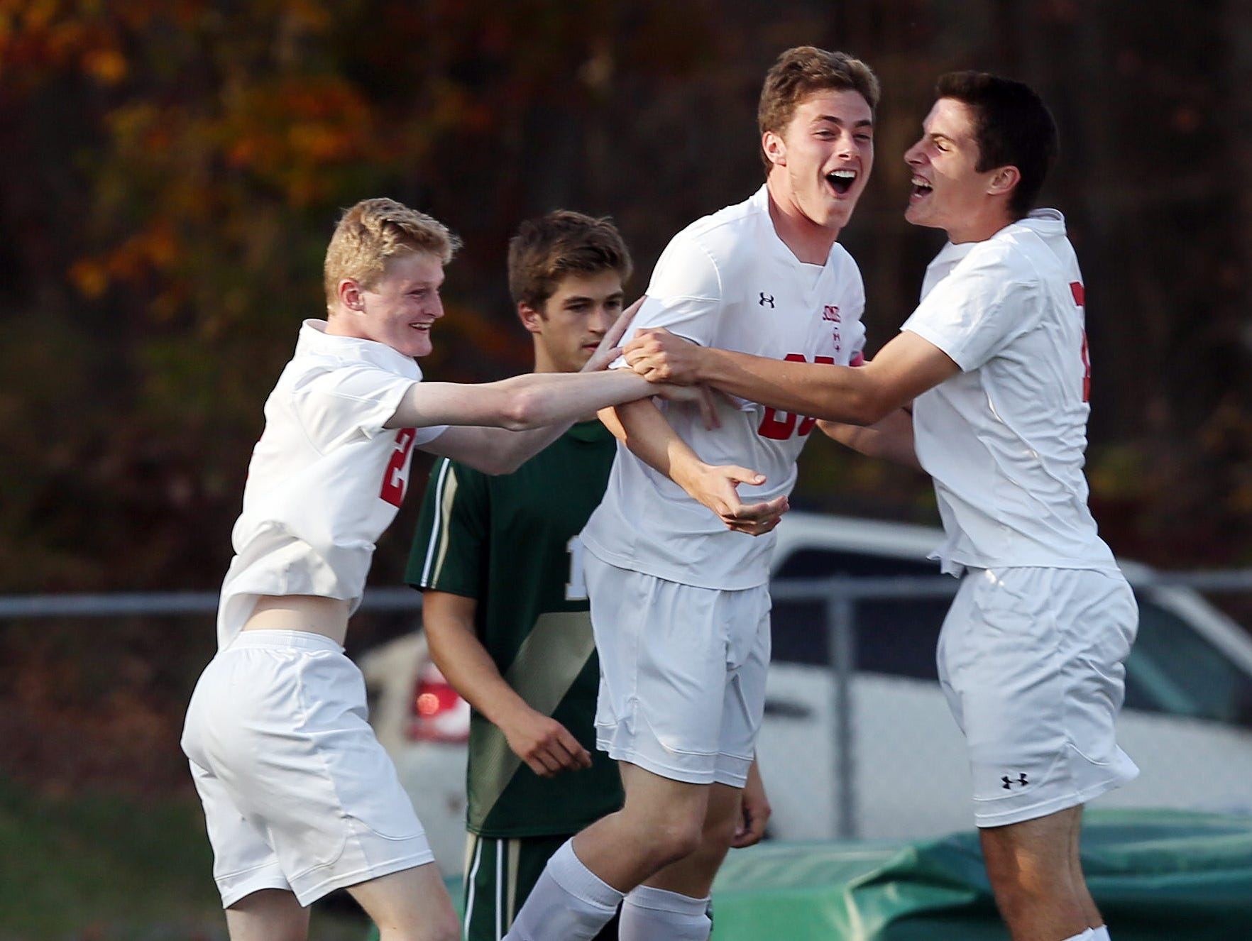 Somers Evan Kieltyka (25) celebrates his first half goal with teammates Jake Faigle (2) and Max Grell (19) against Vestal during the boys soccer regional semifinal at Lakeland High School in Shrub Oak Nov. 2, 2016. Somers won the game 3-0.
