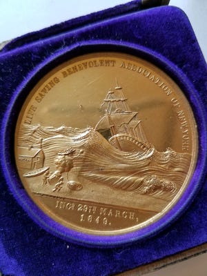 Medal awarded to Martin Knudsen for water rescues in 1892 near Pilot Island.