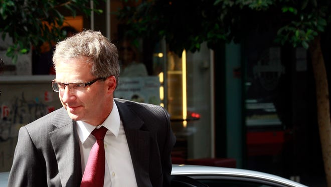 Klaus Masuch of the European Central Bank arrives at Greek finance ministry for a meeting with Yannis Stournaras, unseen, in Athens, Greece, on Sunday, Sept. 22, 2013.