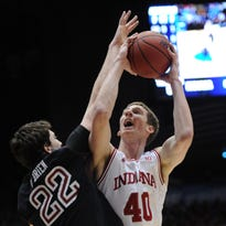 Indiana's Cody Zeller bangs into and shoots over Temple's Jake O'Brien,left, in the first half of their game Sunday afternoon in the third round of the NCAA Men's Basketball Tournament at the University of Dayton Arena in Dayton OH. The Hoosiers defeated the Temple Owls 58-52. Matt Kryger / The Star