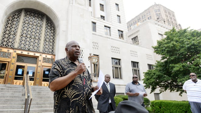 Artis Cash, chairman of the National Action Network in Shreveport, hosts a unity vigil on the Milam Street side of the Caddo Parish Courthouse Saturday morning.