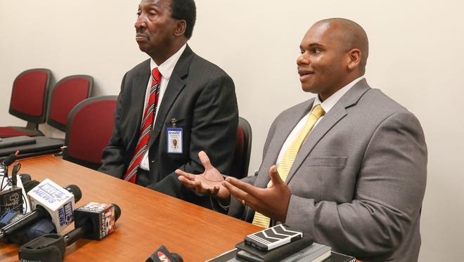 State Education board chairman Milton Seymore (left) with Wayne Lewis, interim education commissioner