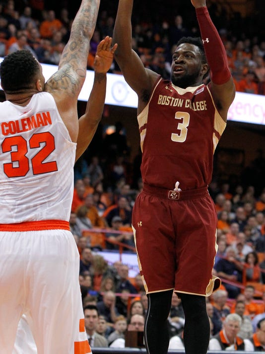 Boston College's Eli Carter, right, shoots over Syracuse's Dajuan Coleman, left, in the first half of an NCAA college basketball game in Syracuse, N.Y., Wednesday, Jan. 13, 2016. (AP Photo/Nick Lisi)