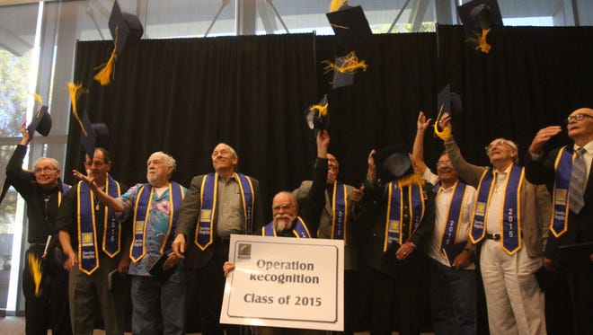 """Veterans toss their caps up in the air after """"graduating"""" during the 9th annual Operation Recognition Ceremony for veterans. Juan Peña, who served in the Marine Corps, received a high school diploma at the Moreno Valley Conference and Recreation Center in Moreno Valley on November 10, 2015."""