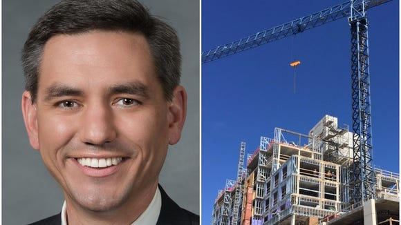 Rep. Brian Turner, left, and the Cambria Suites hotel under construction in downtown Asheville.