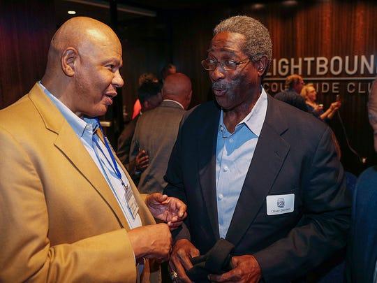 Earle Higgins,left, and Oliver Darden talk during the