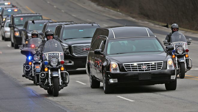"IMPD, Sheriff, and State Police officers travel on Meridian St. as they escort the body of Boone Co. sheriff's deputy Jacob ""Jake"" Pickett from St. Vincent's Hospital downtown to the Marion County Coroner's office, Monday, Mar. 5, 2018.  The officer, who was helping Lebanon police officers serve a warrant Friday, Mar. 2, 2018, was fatally wounded.  He was taken off life support earlier this morning."