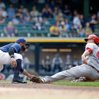 Cincinnati's Scott Schebler is tagged out attempting to steal second base by Jonathan Villar during the third inning at Miller Park. The last-day attendance was 31,776, which was also the Brewers' 'Give Back Game.'
