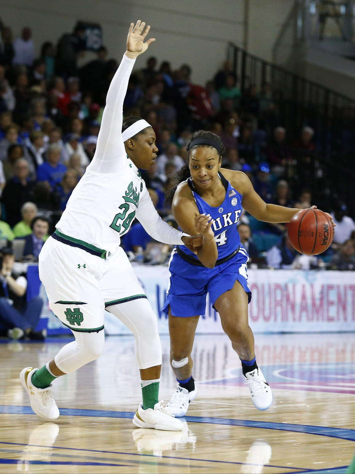 Duke Blue Devils guard Lexie Brown (4) drives the ball
