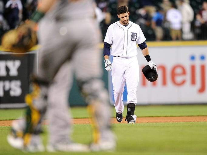 Tigers' J.D. Martinez (28) leaves the field after hitting