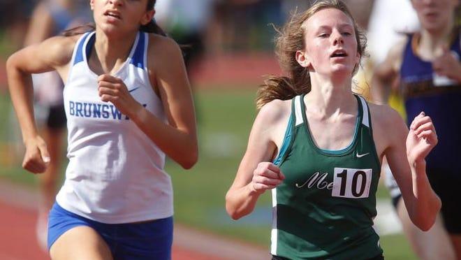 Brunswick's Emily Bardwell finishes alongside Medina's Juliette Keller in the 1,600 meter run at the state tournament June 2, 2018, at Jesse Owens Memorial Stadium in Columbus.