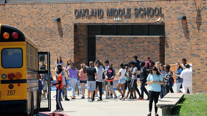 Oakland Middle School students get out of school early in a past school year.