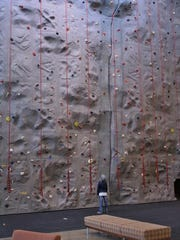A youngsters checks out the rock climbing wall at Western Oregon's new Health and Wellness Center.