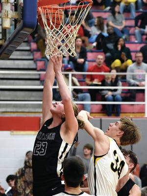 Culleoka's Erik Mick (23) powers in two of his game-high 16 points as the Warriors surprised top seed Santa Fe 60-50 in Friday's District 10-A Tournament semifinal at Mt. Pleasant. Culleoka will face the host Tigers in Monday's 7:30 p.m. championship game.