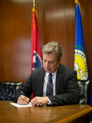 Maury County Mayor Andy Ogles signs Resolution No. 02-20-31, protecting the Second Amendment of the United States Constitution, in his office on Friday.