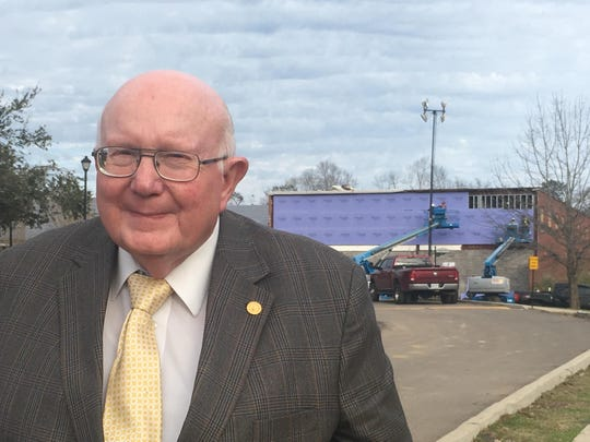 William Carey University President Tommy King stands in front of a WCU building under repair. The university sustained major damage from the Jan. 21 tornado.