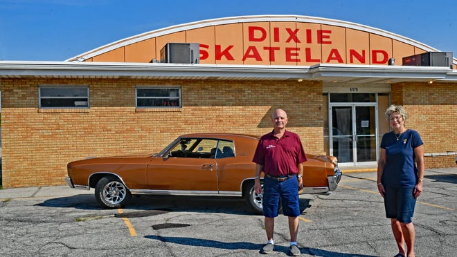 Terry Barrett, president of the Downriver Wanderers Car Club, and Kathy Berns, co-owner of Dixie Skateland at 5179 N. Dixie Hwy., stand in front of a 1972 butterscotch Monte Carlo that Barrett will enter in a free car show at the skateland Saturday.
