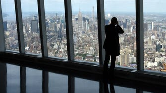 A visitor to One World Observatory looks over Manhattan. The observatory will open to the public on May 29.