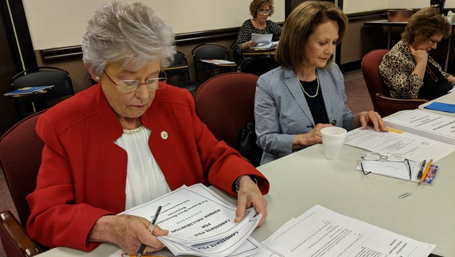 Gov. Kay Ivey (left) and State Board of Education Vice President Stephanie Bell (right) review superintendent applications on April 13, 2018.