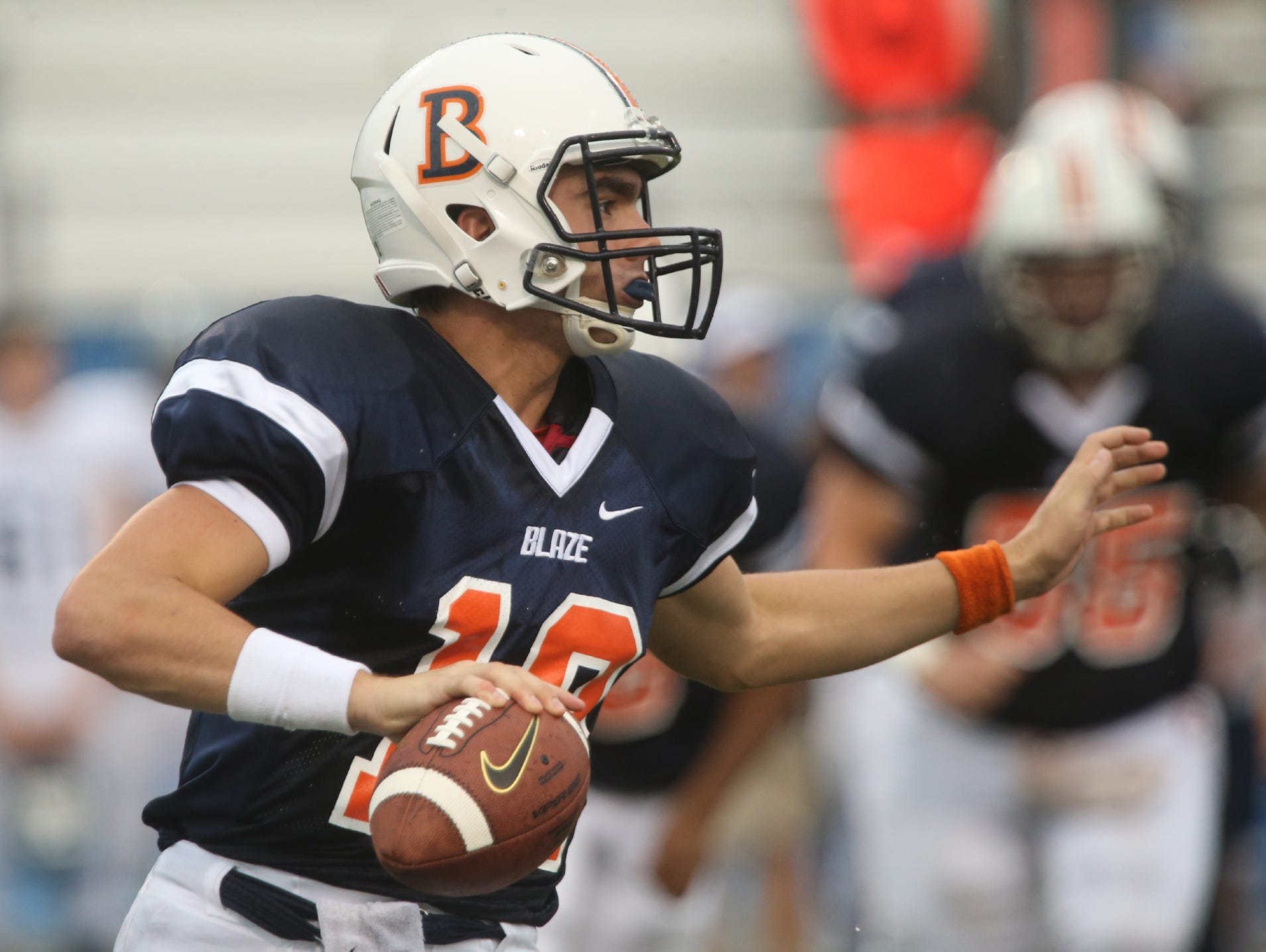 Blackman's quaterback Miller Armstrong scrambles in the backfield looking for a receiver during the first game of the Middle Tennessee Classic against Chalkville at MTSU's Floyd Stadium Saturday, Aug. 22, 2015.
