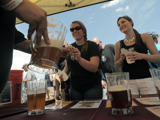 Beer is poured during the Gnarly Barley Brew Festival at a past Larimer County Fair & Rodeo.