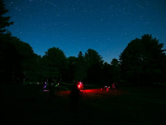 """Participants of photographer Curt Weinhold's """"nightscape"""""""