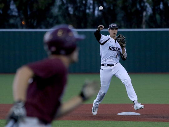 Rider's Parker Kelly throws to first for the out against