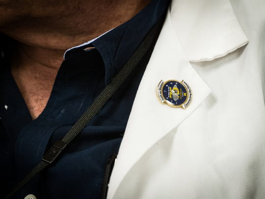 Dr. Rex Herbert, an orthopedic surgeon at the Lebanon VA Medical Center, wears a Navy Seabees pin on his lapel on Wednesday, August 9, 2017. A Navy Seabee veteran gave him the pin and made Herbert an honorary Seabee after he performed surgery on the veteran.