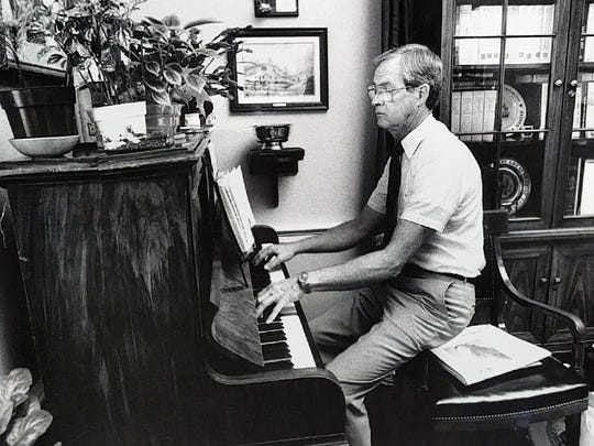"Around 8 a.m. in his office next to the U.S. Capitol in the 1990s, Bill Goodling plays a 100 year old piano given to him by his staff after eating breakfast. Goodling said, ""I only play for a minute"", as he prepared to start his day."