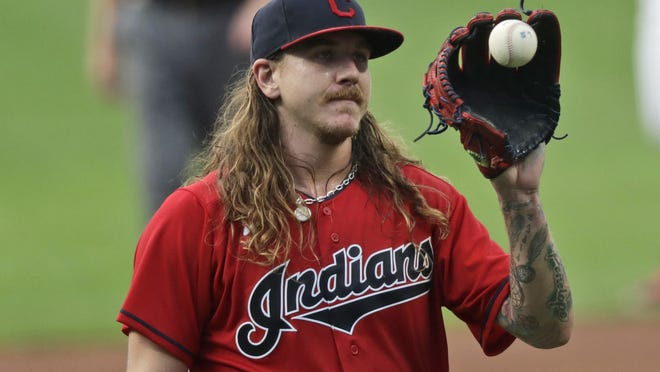 Cleveland Indians starting pitcher Mike Clevinger gets another ball after giving up a home run to Minnesota Twins' Max Kepler in the first inning in a baseball game, Wednesday, Aug. 26, 2020, in Cleveland.