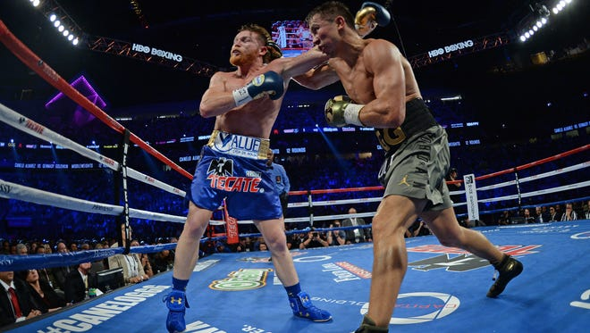 Gennady Golovkin, right, and Canelo Alvarez box during the world middleweight boxing championship in Las Vegas last September. The bout ended in a draw.