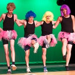 Four members of the male chorus line, Nick Hartterode, Ben Hatch, Kevin Howard, and Cole Schneider do kicks during a technical rehearsal for the Harper Creek Beaveriety show.