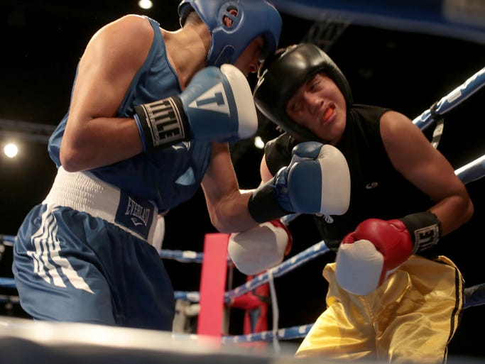 Bryan Lua, left, with Indio Boys and Girls Club, hits Bryan Pinzon with Pinzon's Boxing in the 132 LBS class in Saturday's finals at the Desert Showdown Tournament at Fantasy Springs in Indio on July 19, 2014.