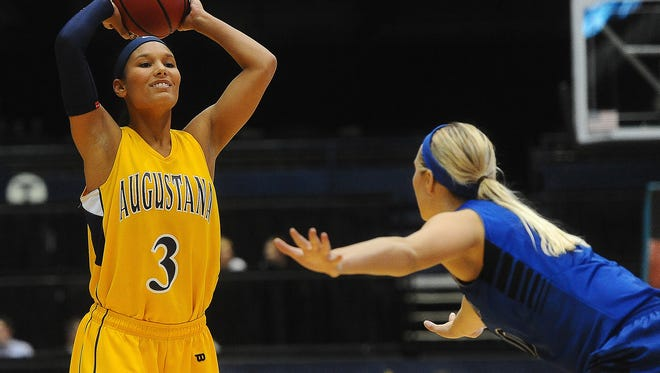 Augustana's Shaunteva Ashley looks to pass around Dakota State's BreeAna Olson during their game at Sioux Falls Arena on Wed., Nov. 19, 2014.