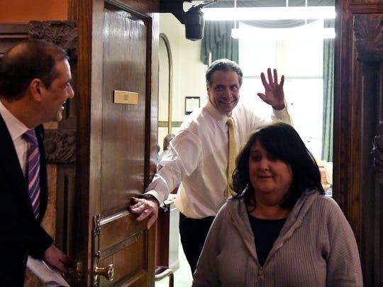 New York Gov. Andrew Cuomo, center, talks with Sen.