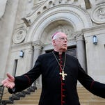 Bishop Paul Swain talks about raising awareness of threats to protect religious liberty after the prayer service at St. Joseph Cathedral in Sioux Falls, S.D., Monday, June 29, 2015.