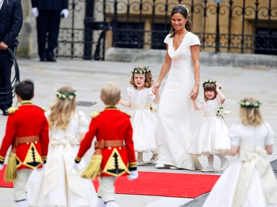 Pippa Middleton escorts pageboys and bridesmaids in Westminster Abbey at the her sister's Royal Wedding in London, April 29, 2011.