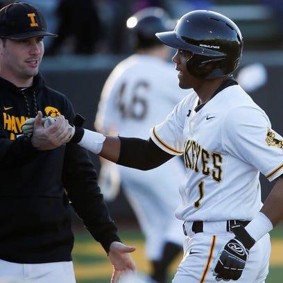 Lorenzo Elion greets Chris Whelan during an Iowa baseball