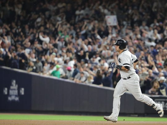 Gary Sanchez rounds the bases for his seventh inning solo home run during Game 5, Wednesday, October 18, 2017.