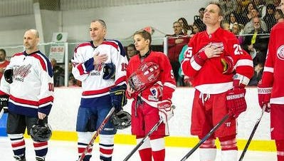 Westland Mayor William Wild headed the Wild Wings while his son, Luke, 13, (center) joined Darren McCarty on Detroit Red Wings alumni team for the annual charity Hockey Night in Westland game in this 2016 file photo.