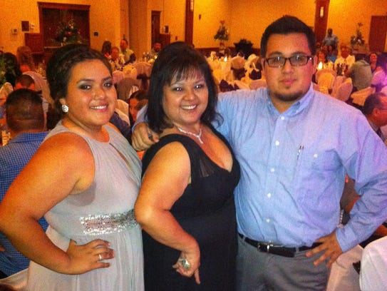 Kathy Melendez, center, and two children, Katy and