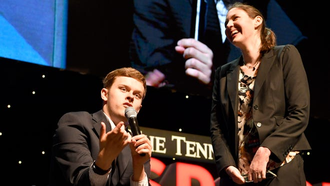 Hunter Garstin accepts the Courage Award from presenters Kaia Jergenson and John Dwyer at The Tennessean Sports Awards presented by Farm Bureau Health Plans at the Tennessee Performing Arts Center's Andrew Jackson Hall on Tuesday, June 6, 2017 in Nashville, Tenn.