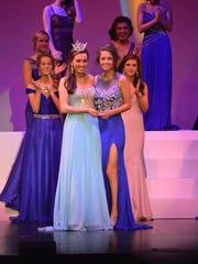 Miss Door County's Outstanding Teen, Ashton Spritka, right, receives the Fan Favorite Award at the Miss Wisconsin's Outstanding Teen pageant from Miss Wisconsin's Outstanding Teen 2014, Elise O'Connell, in Oshkosh.
