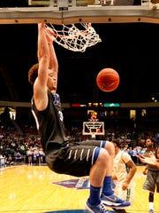Middle Tennessee forward Reggie Upshaw Jr. (30) slam-dunks
