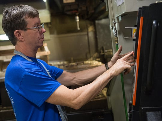 Machinist Jim Kelly works on a 3-axis vertical CNC mill at Advanced Machine & Tool. To support its growth, the company  launched an internal training program for its 65-person workforce.