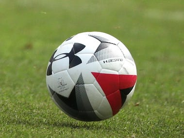 A soccer ball lies on the pitch.