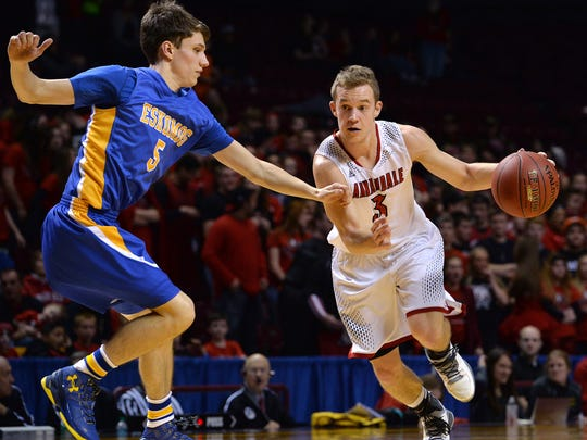 Annandale's Brock Fobbe (3) drives the ball past Esko's Trenton Menor (5) during the first half of the Class 2A boys state basketball tournament quarterfinal game Wednesday at the University of Minnesota's Williams Arena in Minneapolis.
