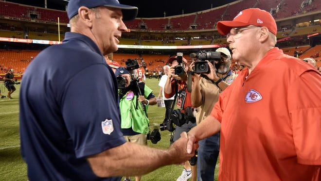 Titans coach Mike Mularkey and Chiefs coach Andy Reid shake hands after the Chiefs beat the Titans 30-6 in a preseason game at Arrowhead Stadium.